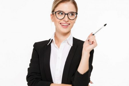Happy blonde business woman in eyeglasses with pen in hand having idea and looking away over white background